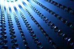闪亮指示水晶在轻的背景中 免版税库存图片