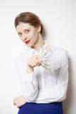 闪光和拿着美元的美丽的女实业家 免版税库存图片