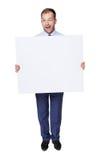 闪光商人显示空白的广告委员会,隔绝在白色 免版税库存照片