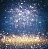 闪光的圣诞节背景-闪烁金子和蓝色与闪耀 免版税图库摄影