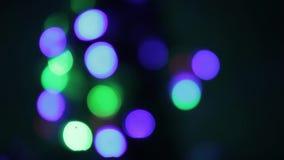 闪动的色的光 假日和党,抽象设计元素,夜城市是Defocused与尼斯Bokeh 股票视频
