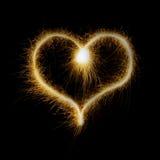 闪烁发光物做的心脏被隔绝在黑背景 库存图片