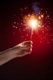 闪烁发光物在手中 免版税库存图片