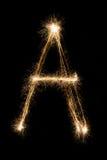 从闪烁发光物字母表的英国信件A在黑背景 免版税库存照片