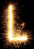 闪烁发光物烟花在黑色的光字母表L 免版税库存照片
