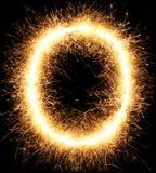 闪烁发光物烟花在黑色的光字母表O 库存照片