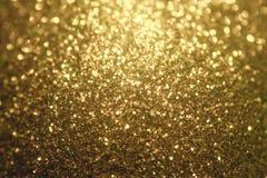 闪烁圣诞节背景,发光的纹理,金闪闪发光背景 库存照片