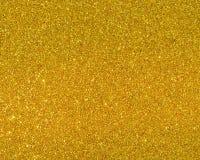 闪烁的金黄尘土表面详细的纹理  库存图片