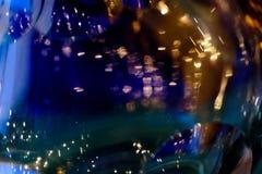 闪烁葡萄酒深蓝背景 非被聚焦的金,蓝色和黑摘要 库存照片