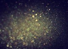 闪烁葡萄酒点燃背景 轻的金子和黑色 库存照片