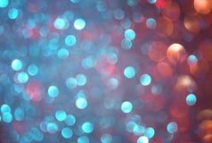 闪烁葡萄酒点燃背景 蓝色,棕色和紫色混杂的颜色 defocused 免版税库存图片