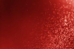 闪烁轻的抽象红色bokeh圣诞节弄脏了背景 免版税图库摄影