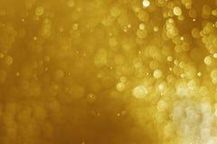闪烁轻的金bokeh圣诞节被弄脏的背景 库存图片