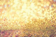 闪烁金bokeh Colorfull弄脏了bir的抽象背景 库存照片