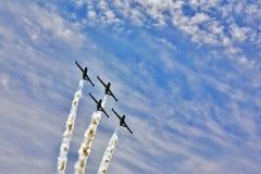 闪耀四架的飞机 库存照片