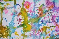 闪耀的了不起的冬天点燃金蓝色蜡生动的水彩油漆,五颜六色的颜色 库存照片