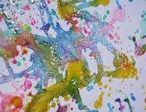 闪耀的冬天点燃金蓝色蜡生动的水彩油漆,五颜六色的颜色 免版税图库摄影