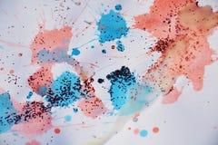 闪耀的桃红色蓝色蜡斑点构造,给冬天背景打蜡 库存图片