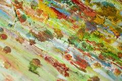 闪耀的泥泞的蓝色金子桃红色绿色磷光性背景和蜡 库存图片