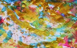 闪耀的金蓝色蜡状的柔和的淡色彩察觉水彩被弄脏的蜡状的金斑点五颜六色的颜色,刷子, backgrounnd冲程  免版税库存照片
