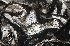 闪耀的闪光金属片的织品纹理 免版税库存图片