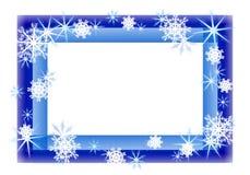 闪耀蓝色边界的雪花 库存照片