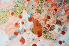 闪耀蜡状的软的桔子对比抽象背景 库存照片