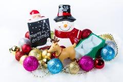 闪闪发光球和雪供以人员装饰一圣诞节 图库摄影