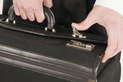 闭合值的手提箱 免版税库存图片
