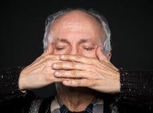 闭合的年长眼睛人 免版税库存图片