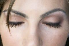 闭合的眼睛妇女 免版税库存照片