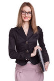 戴闭合的膝上型计算机佩带的眼镜的微笑的妇女在白色backgr 免版税库存照片