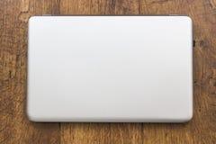 闭合的银色膝上型计算机 免版税库存照片