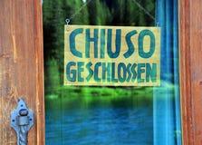 闭合签到德语 免版税库存照片