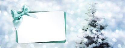问候与被隔绝的绿色丝带弓的礼品券 库存照片