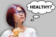 问日本的女孩她的自已,如果食物吃是健康的 免版税库存照片
