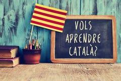 问题vols aprendre catala ?您是否要学会加泰罗尼亚语? 库存图片