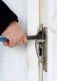 闯入房子的窃贼 免版税库存图片