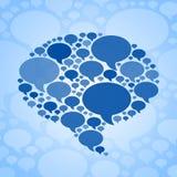 闲谈在蓝色背景的泡影标志 免版税库存照片