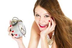 闹钟微笑的妇女 免版税库存照片