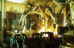 队焊接机器人代表运动 免版税库存照片