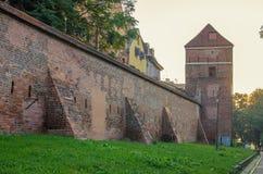 防御墙壁(托伦,波兰)在日出 库存图片