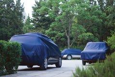 防护汽车的盖子 库存照片