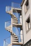 防火梯,在少量的拔塞螺旋楼梯 图库摄影