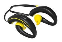 防水耳机、耳机以黄色和黑色 免版税库存照片