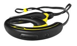 防水耳机、耳机以黄色和黑色 免版税图库摄影