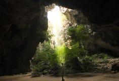 阳光通过一个洞孔在泰国 免版税库存照片
