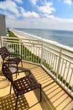 阳台在海滩胜地的晴天 免版税图库摄影