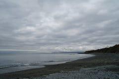 阴沉的海滩 免版税图库摄影