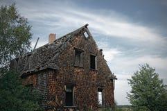 阴沉的被困扰的房子 免版税库存照片